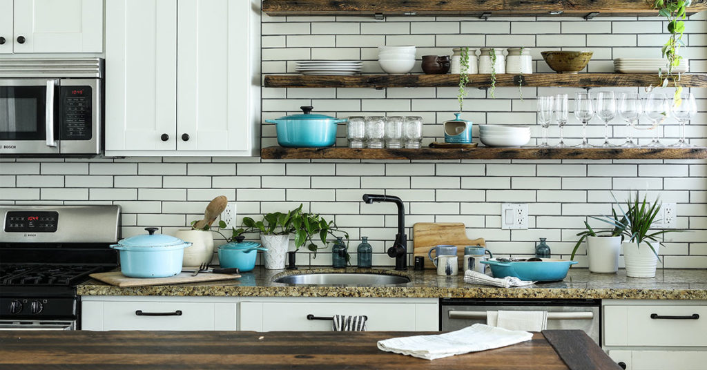 Kitchen with open shelving and white subway tile
