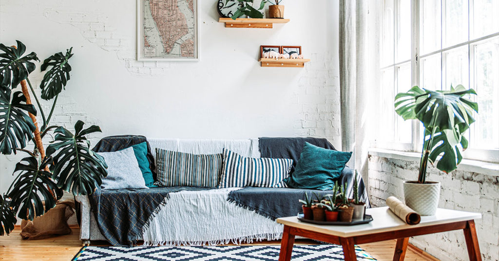 Blue and white bohemian style living room with plants